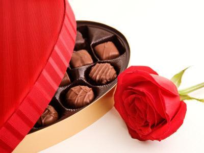 Studio Shot of Box of Romantic Chocolates and Red Rose