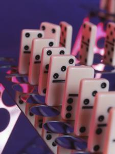 Studio Shot of Dominos Arranged on a Metal Stand