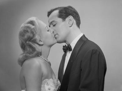 Studio Shot of Kissing Couple in Evening Wear-George Marks-Photographic Print