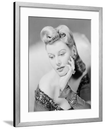 Studio Shot of Mid Adult Woman Resting Head on Hand-George Marks-Framed Photographic Print
