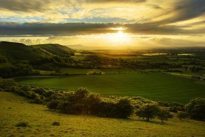 Stunning Countryside Landscape with Sun Lighting Side of Hills at Sunset-Veneratio-Photographic Print