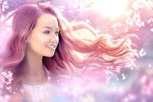 Fantasy Girl with Long Pink Blowing Hair. Spring or Summer Beauty Teen Girl with Flowers. Fashion A by Subbotina Anna