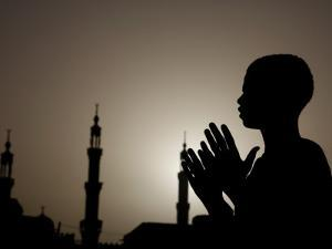 Sudanese Muslim Boy Prays in Front of a Mosque in Sudan