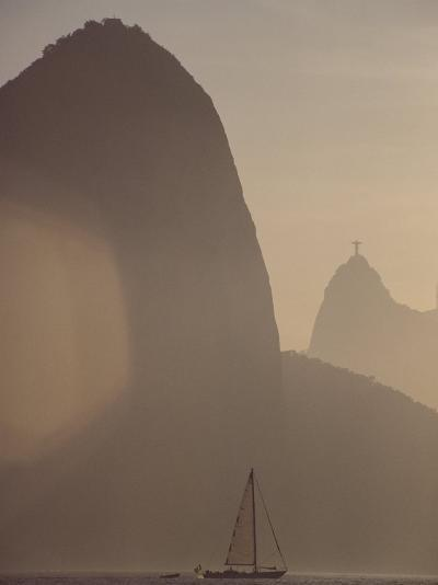 Sugar Loaf Mountain Towers above a Sailboat on Guanabara Bay-Stephanie Maze-Photographic Print
