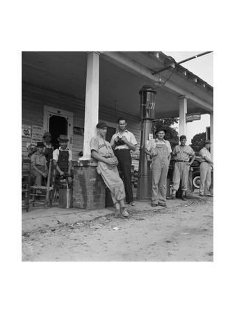 https://imgc.artprintimages.com/img/print/suiting-up-for-baseball-at-the-gasoline-station_u-l-pgjqla0.jpg?p=0