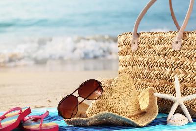 Summer Beach Bag with Straw Hat,Towel,Sunglasses and Flip Flops on Sandy Beach-Sofiaworld-Photographic Print