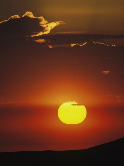 Sun and Clouds at Sunrise, Yellowstone National Park, Wyoming-Raymond Gehman-Photographic Print