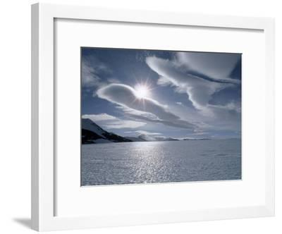 Sun and Lenticular Clouds over a Bare Ice Glacier by Patriot Hills-Gordon Wiltsie-Framed Photographic Print
