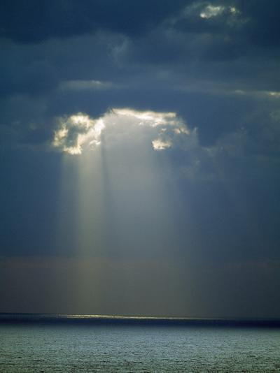 Sun Rays Reaching the Sea Through the Clouds--Photographic Print