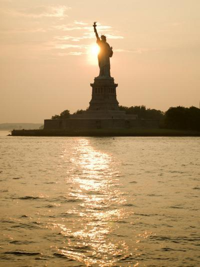 Sun Setting Behind the Statue of Liberty on a Summer Evening-John Nordell-Photographic Print