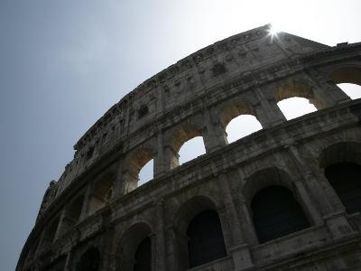 Sun Shining Through Ruins of the Coliseum, Rome, Italy--Photographic Print