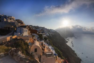 Sunbeam Through the Clouds over the Aegean Sea Seen from the Typical Village of Oia, Santorini-Roberto Moiola-Photographic Print