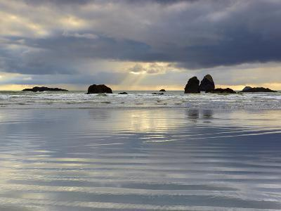 Sunbeams on Cloudy, Stormy Day Behind the Sandy Beach and Offshore Rocks-Patrick Smith-Photographic Print