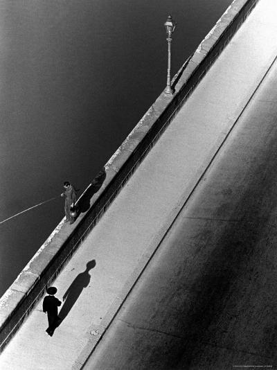 Sunday Morning Along the Arno River, a Man Fishing, and a Passerby Casting a Shadow-Alfred Eisenstaedt-Photographic Print