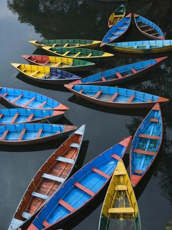 Canoes floating on water