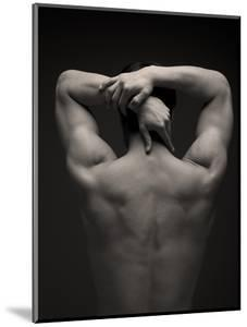 Rear View of a Male Stretching His Arm Behind His Head by Sung-Il Kim