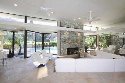 Sunken Seating Area and Exposed Stone Fireplace in Spacious Living Room with View-Nosnibor137-Photographic Print