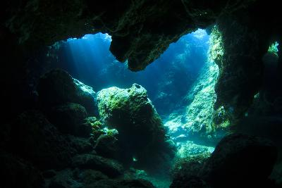 Sunlight Enters Underwater Cave like a Spotlight-Rich Carey-Photographic Print