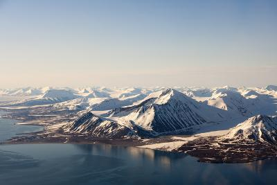 Sunlight Highlights Ice Covered Mountains on Spitsbergen Island-Sergio Pitamitz-Photographic Print