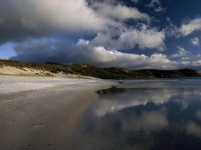 Sunlight Pierces Storm Clouds Illuminating an Empty and Remote Beach-Jason Edwards-Photographic Print