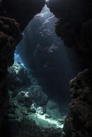 Sunlight Pours into a Submerged Cavern on a Reef in the Solomon Islands-Stocktrek Images-Photographic Print