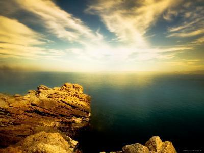 Sunlight Reflecting off Blue Waters off Cliffside-Jan Lakey-Photographic Print