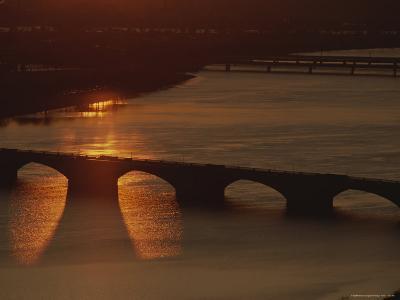 Sunlight Reflects off the Potomac, Silhouetting Memorial Bridge-Sisse Brimberg-Photographic Print