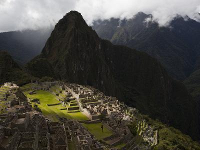 Sunlight Strikes Machu Picchu Through a Break in the Clouds-Michael Melford-Photographic Print