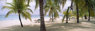 Sunning Tourists on 7-Mile Beach, Negril, Jamaica--Photographic Print