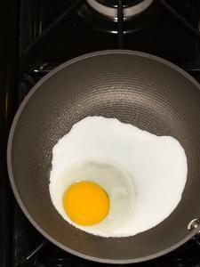 Sunnyside Up Egg Cooking in Frying Pan