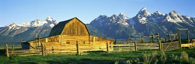 Sunrise over the Moulton Barn Along Mormon Row, Teton Range, Mormon Row Historic District
