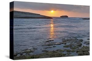 Sunset at the beach near S'Archittu, Province of Oristano, Sardinia, Italy