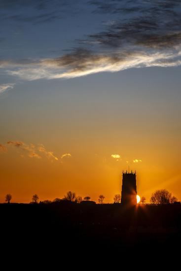 Sunset Behind the Parish Church of the Holy Trinity and All Saints at Winterton on Sea, England-Andrew Sproule-Photographic Print