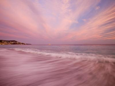 Sunset Creates a Pink Cast over the Surf in the South of France-Michael Melford-Photographic Print