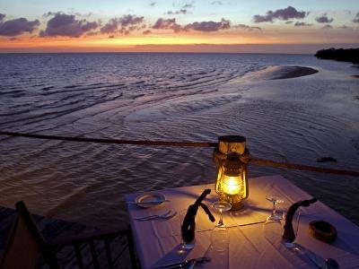 Sunset Dining on the Jetty, Fundu Lagoon Resort, Pemba Island, Zanzibar, East Africa-Paul Harris-Photographic Print
