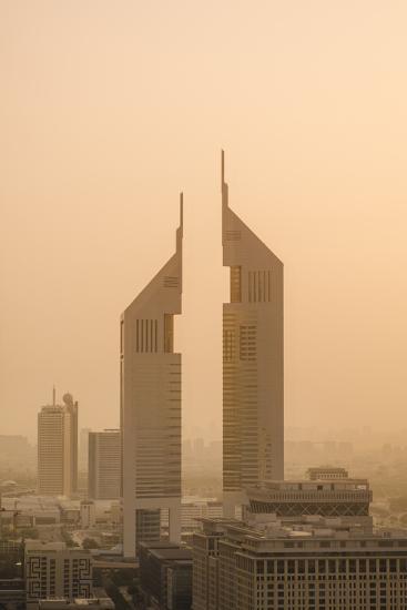 Sunset Engulfs the Jumeirah Emirates Towers Hotel Dubai, Uae-Michael DeFreitas-Photographic Print
