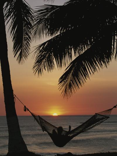 Sunset on Beach with Silhouetted Hammock and Palms, Costa Rica-Michael Melford-Photographic Print