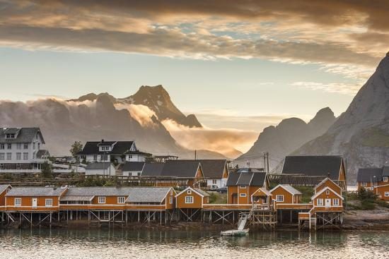 Sunset on the Fishing Village Framed by Rocky Peaks and Sea, Sakrisoya, Nordland County-Roberto Moiola-Photographic Print