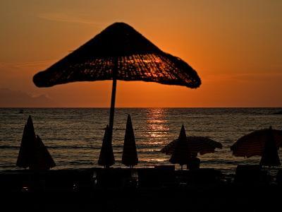 Sunset on Umbrellas, Kusadasi, Turkey-Joe Restuccia III-Photographic Print