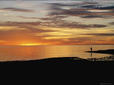 Sunset over a Distant Fisherman-Clarita Berger-Photographic Print