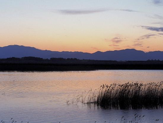 Sunset over a Peaceful Lake with Silhouette of Mountains--Photographic Print