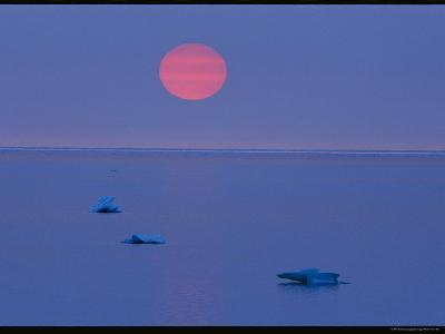 Sunset Over Calm Hudson Bay Waters Dotted with Small Ice Chunks-Norbert Rosing-Photographic Print