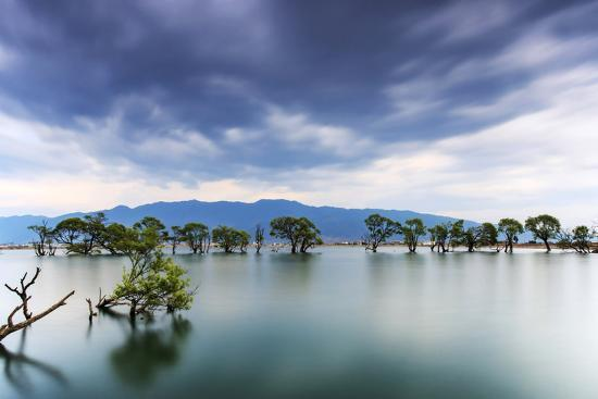 Sunset over one of the many lakes in the village of Heqing in Yunnan, China-ClickAlps-Photographic Print