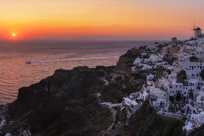 Sunset over the Aegean Sea Seen from a Cliff-Top Town on Santorini Island-Babak Tafreshi-Photographic Print