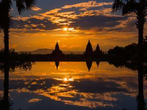 Sunset reflected in the infinity pool at Aureum Palace Hotel, Bagan, Mandalay Region, Myanmar