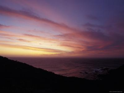 Sunset Reflects Off a Cloud Band Passing over a Rugged Coastline, Australia-Jason Edwards-Photographic Print