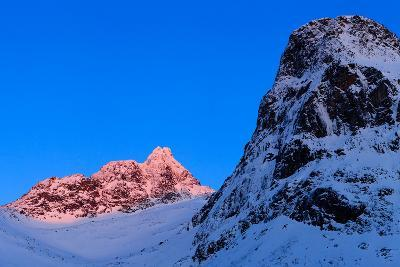 Sunset Shines on Snow-Covered Rugged Mountains Near Tromso, Norway-Babak Tafreshi-Photographic Print