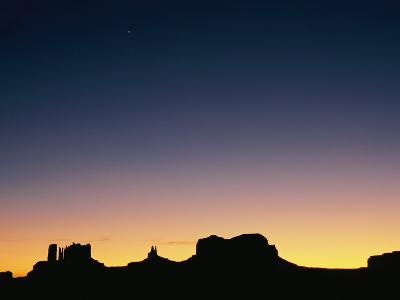 Sunset Silhouetting the Desert Landscape-Rich Reid-Photographic Print
