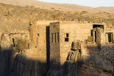 Sunset Touches the Walls of an Ancient Mud Brick Village on a Desert Gorge Mountainside-Jason Edwards-Photographic Print