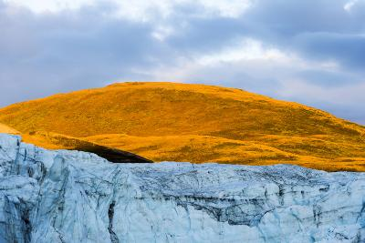 Sunset Turns the Exposed Summit of a Mountain Orange Above a Glacier Fracture Zone-Jason Edwards-Photographic Print